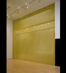 """""""Untitled"""" (Golden), 1995 by Felix Gonzalez-Torres (American, b. Cuba, 1957–1996). Strands of beads and hanging device. Collection SFMOMA."""
